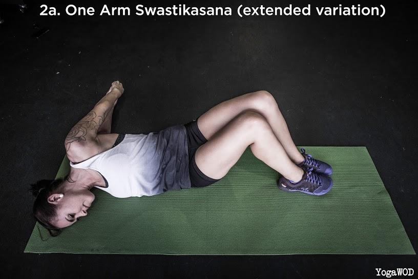 one arm swastikasana ext variation front header