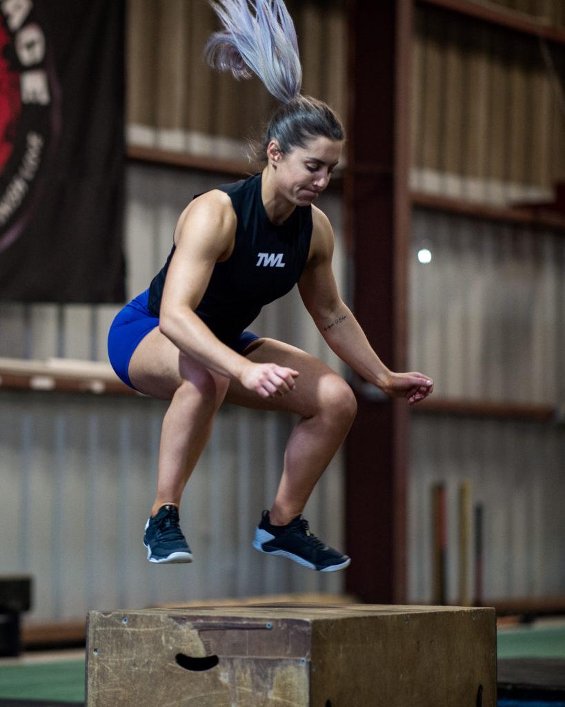 female athlete doing box jumps
