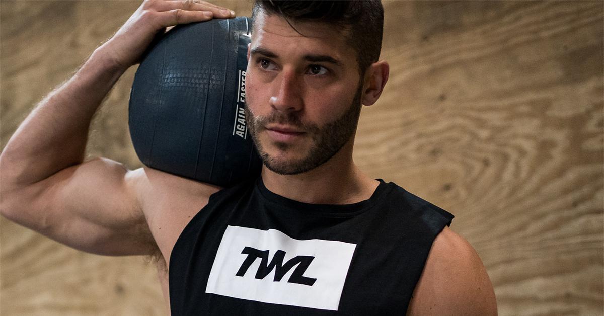 male athlete holding slam ball