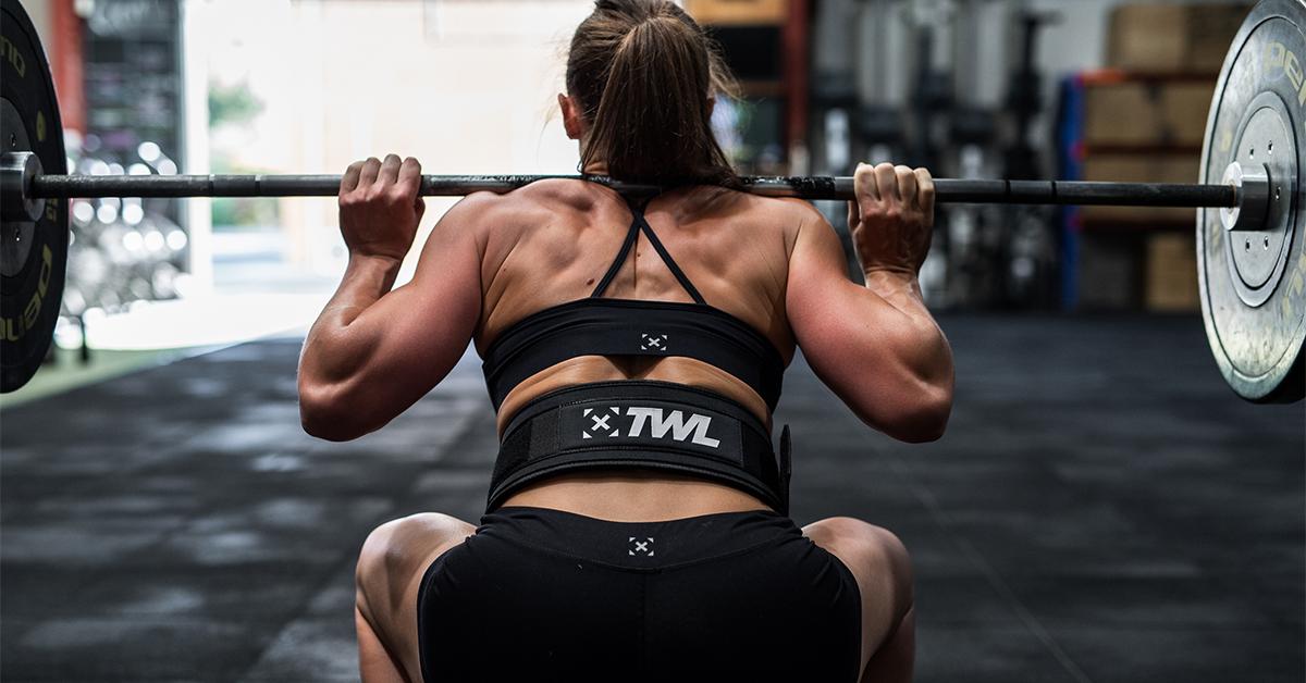 female athlete back squatting