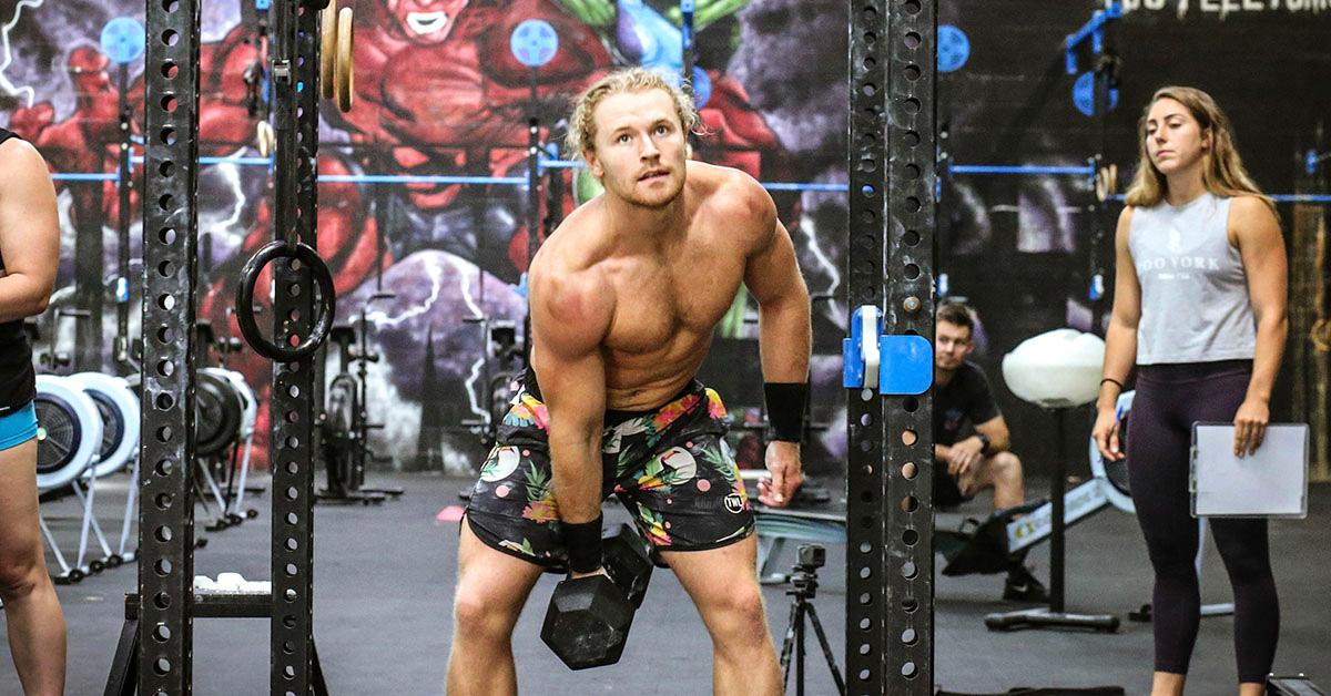 athlete doing dumbbells wods