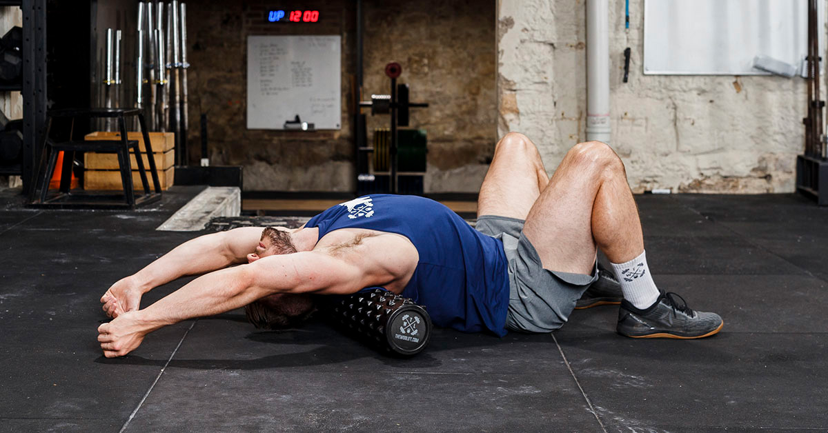 athlete rolling out back on foam roller