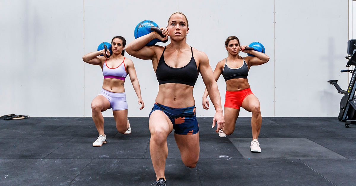 athletes doing kettlebell lunges