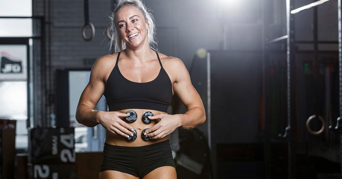 athlete wearing compex muscle stimulator
