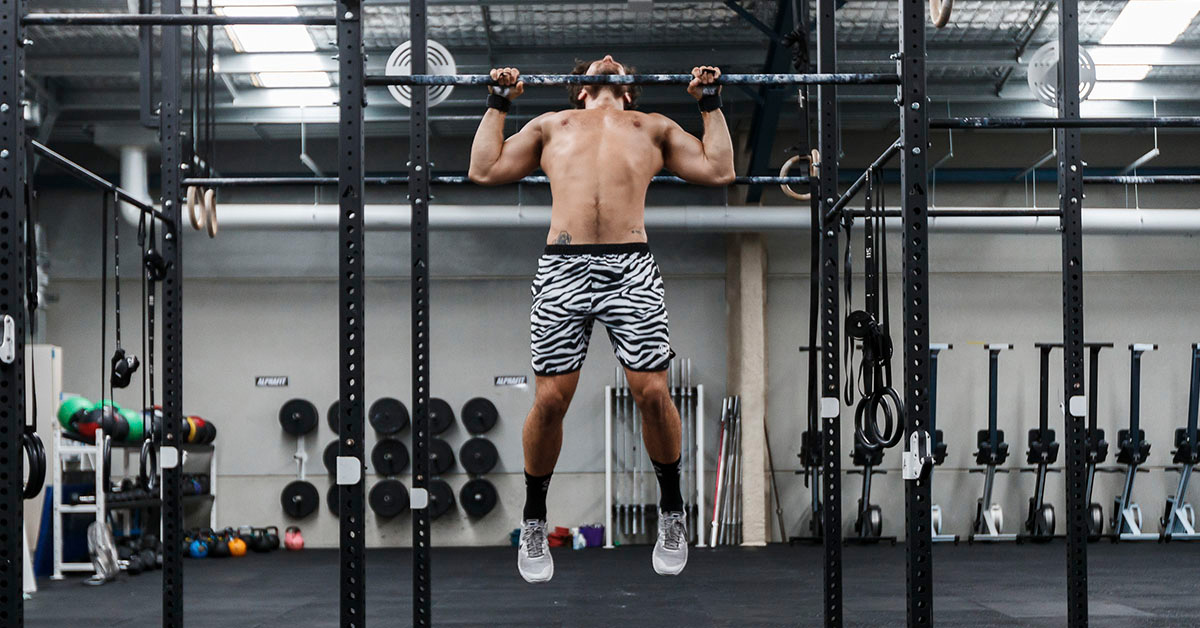 khan doing chest-to-bar butterfly pull-ups