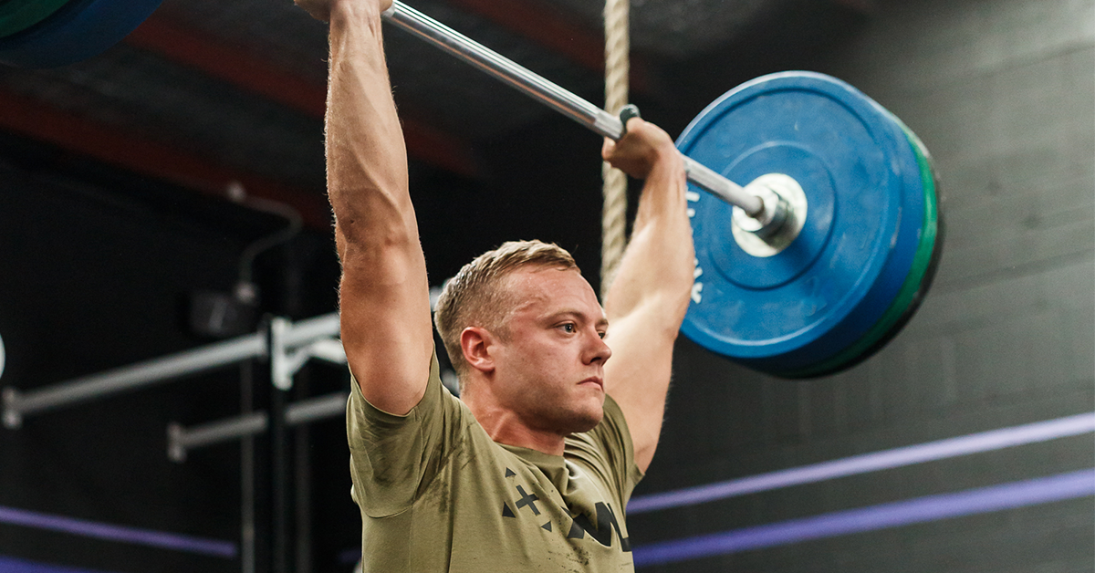 male athlete with barbell overhead