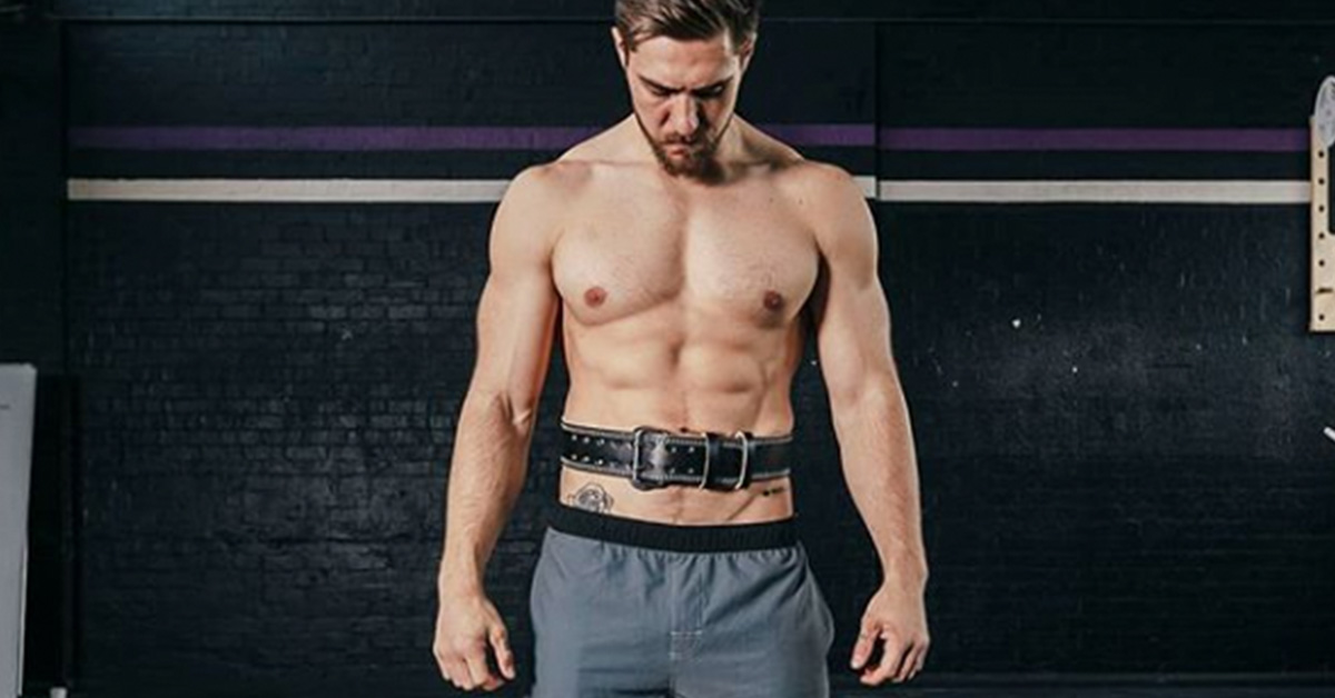 khan wearing a weightlifting belt