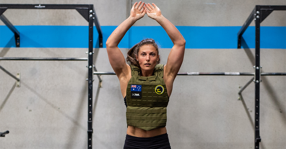 female athlete doing burpees with weighted vest