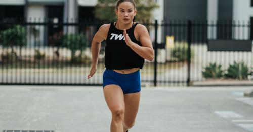 female athlete running outside