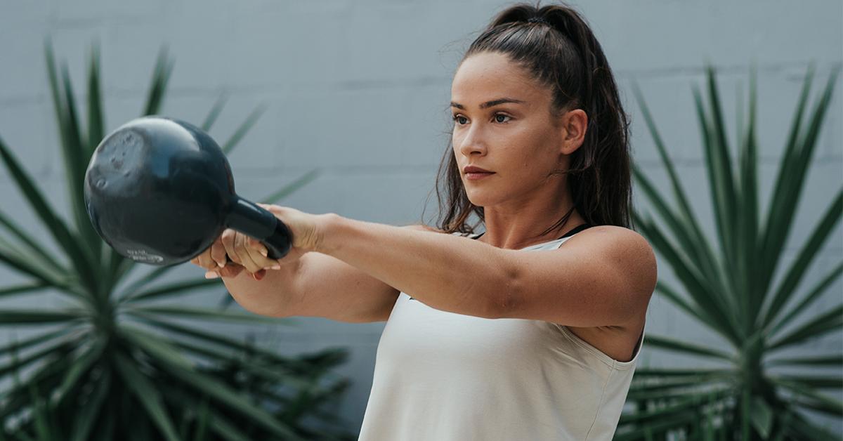 female athlete doing russian kettlebell swings
