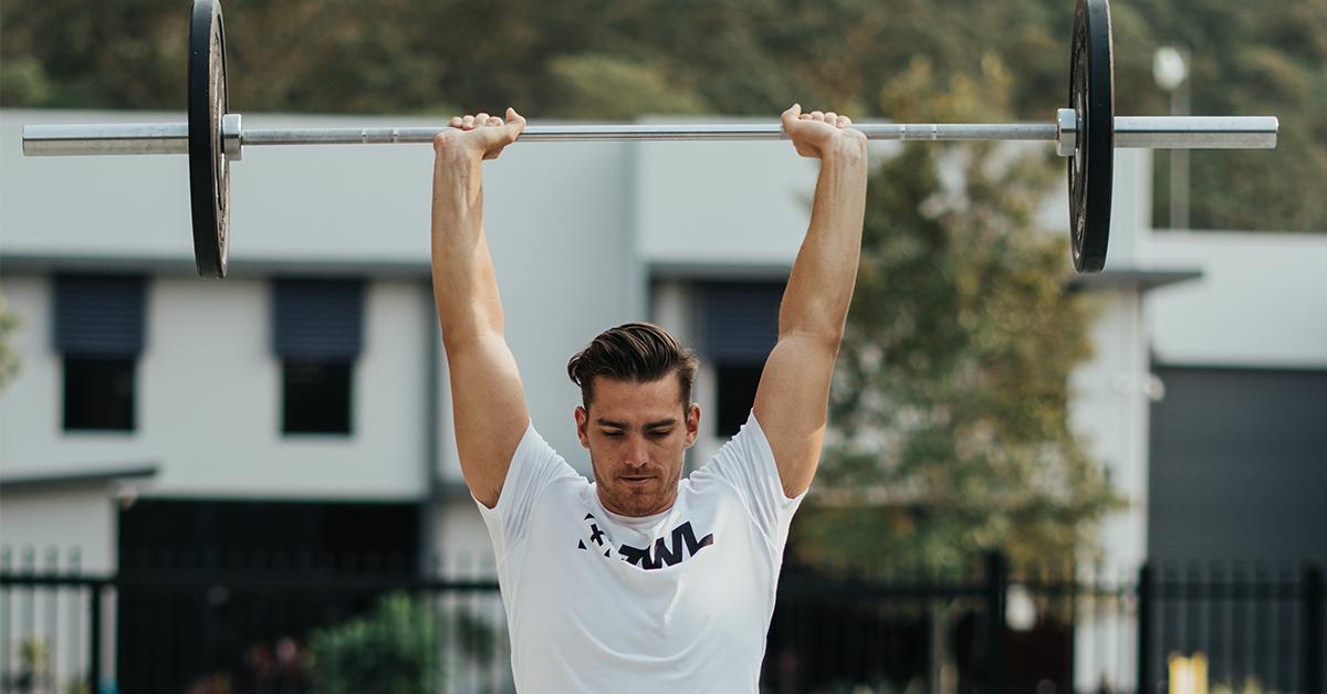 male athlete performing push jerk