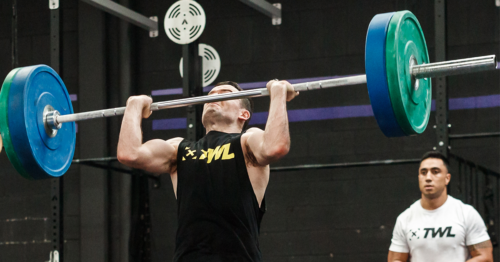 male athlete performing thruster