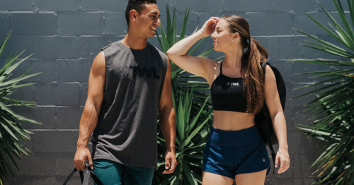 man and woman athlete walking outside
