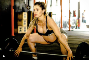 pregnant woman training snatch Olympic lift