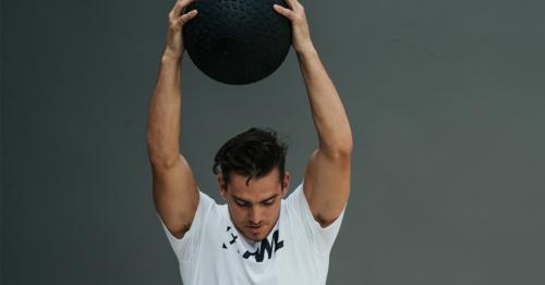 athlete doing medicine ball exercises