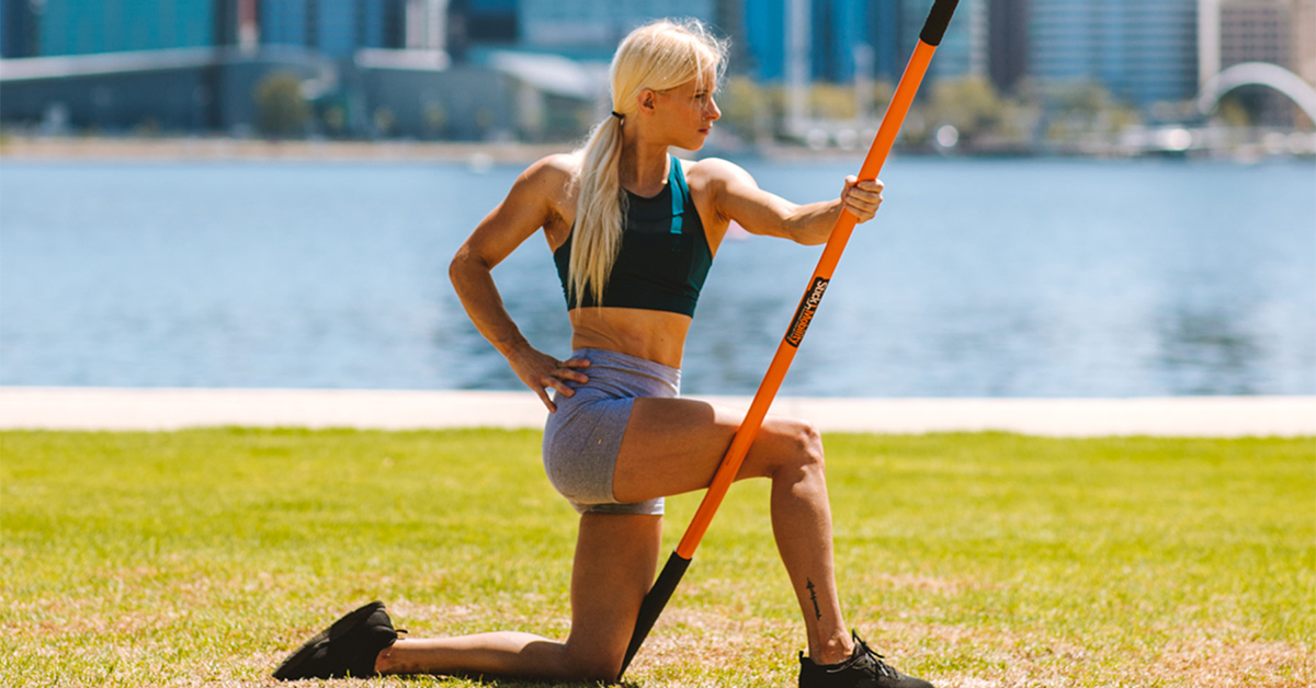 athlete stretching with a mobility stick