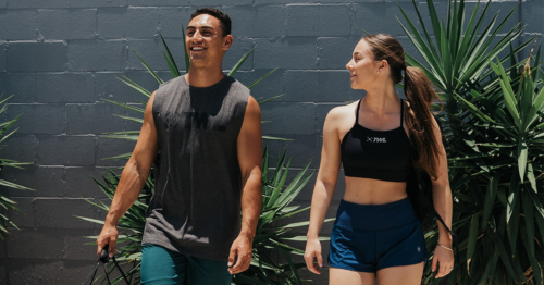 male and female athlete walking outside
