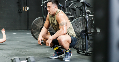athlete with tight glutes squatting