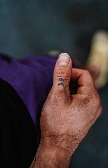 khan porter double arrow tattoo