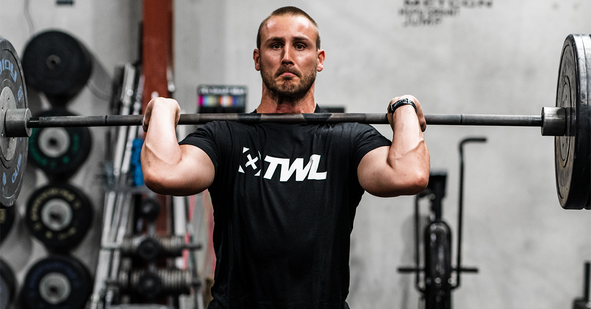 man with barbell in front rack position
