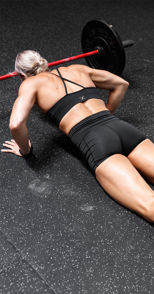 female athlete are burpees cardio