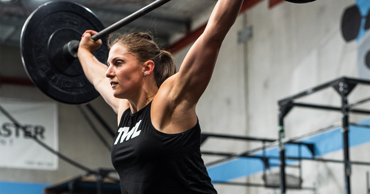 female athlete using olympic barbell