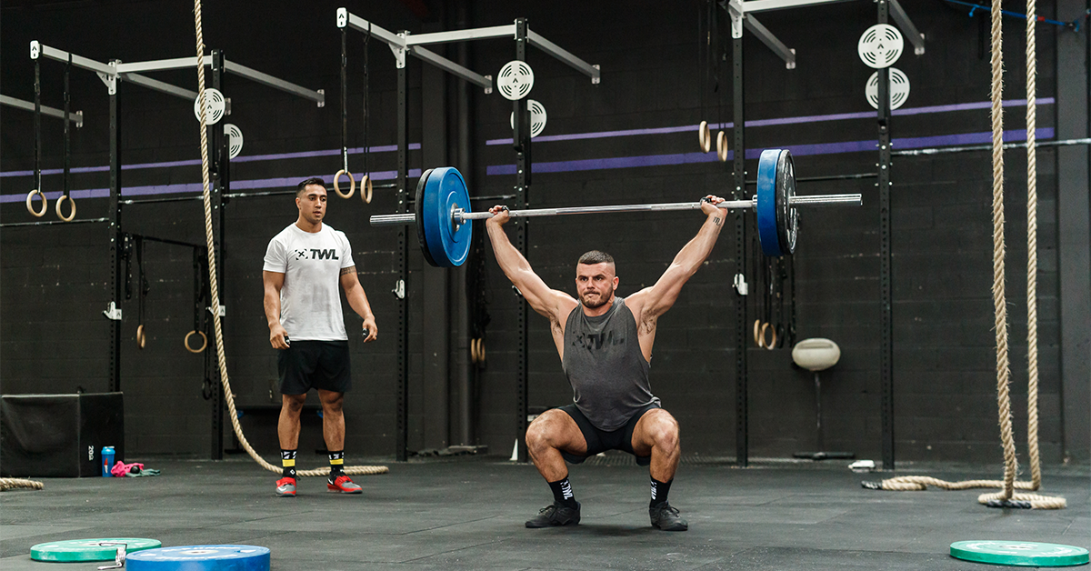 male athlete performing snatch lift