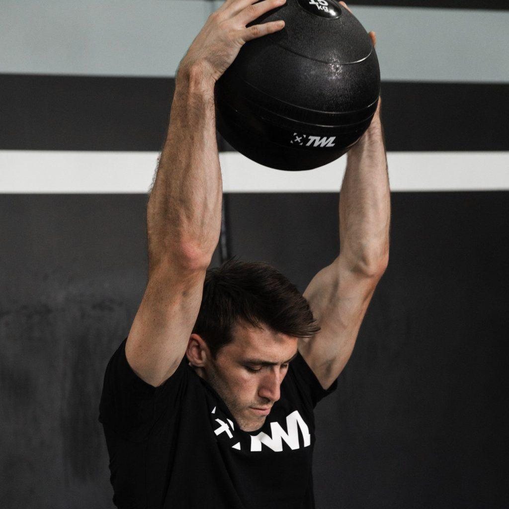 athlete doing slam ball throws