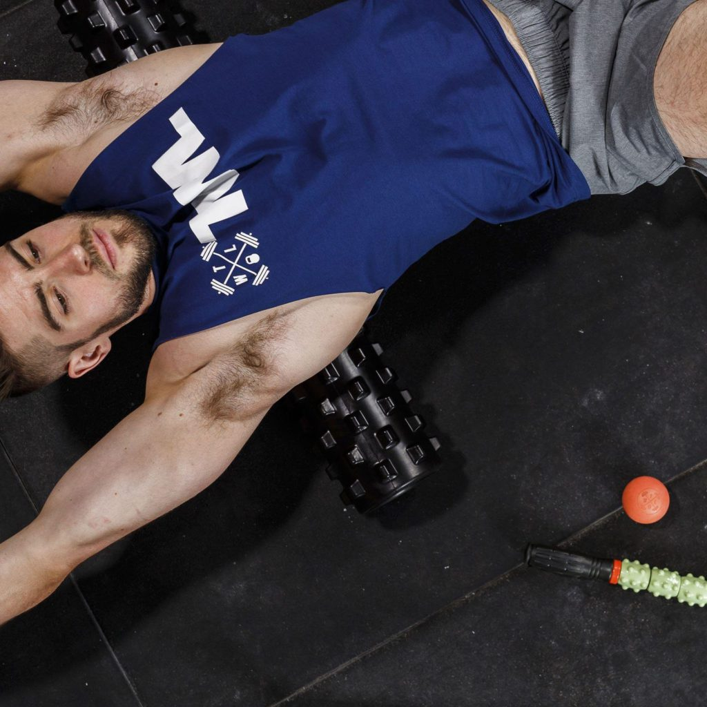 athlete on foam roller for trigger point relief