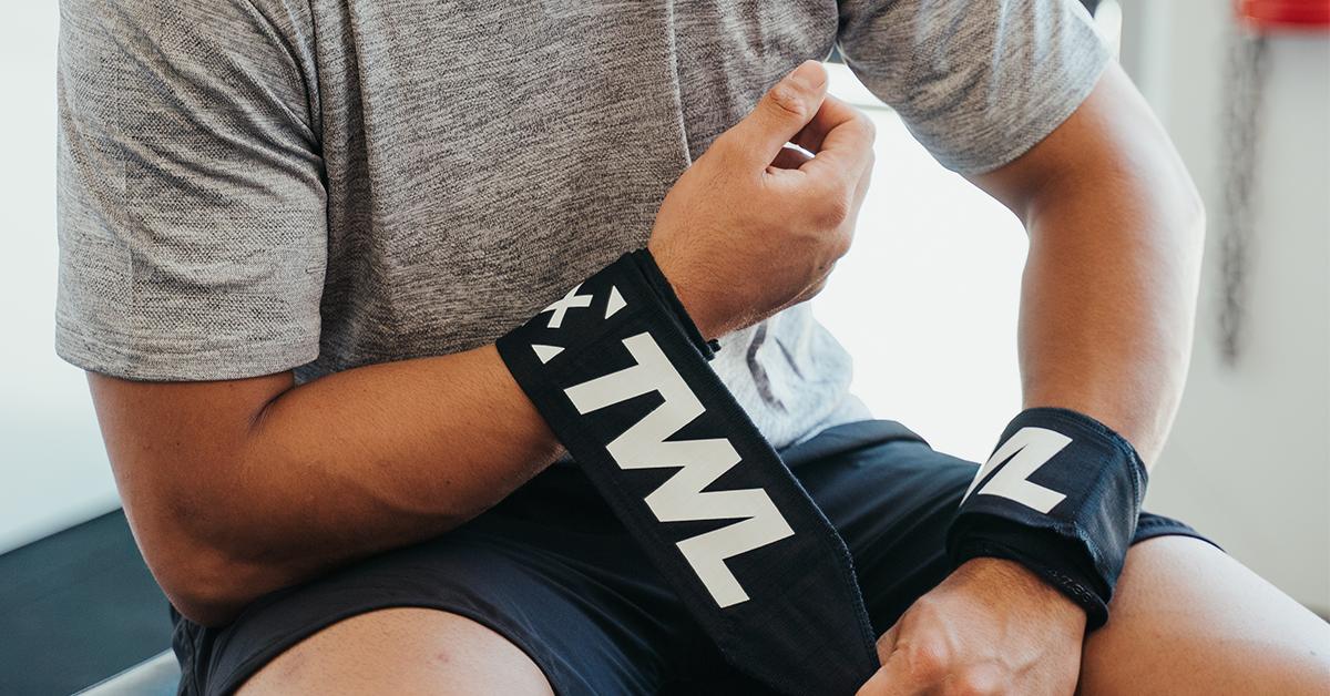 athlete putting on wrist wraps