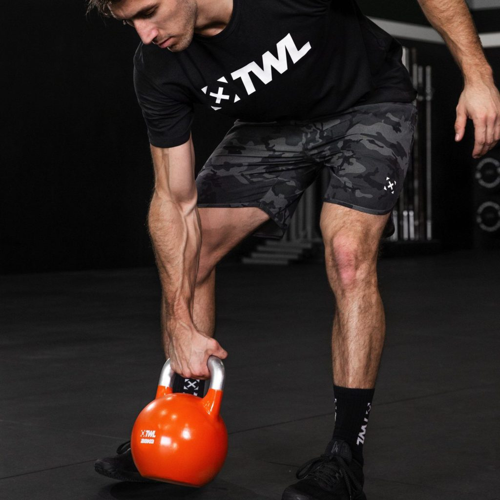 athlete using kettlebell as best home gym equipment for small spaces