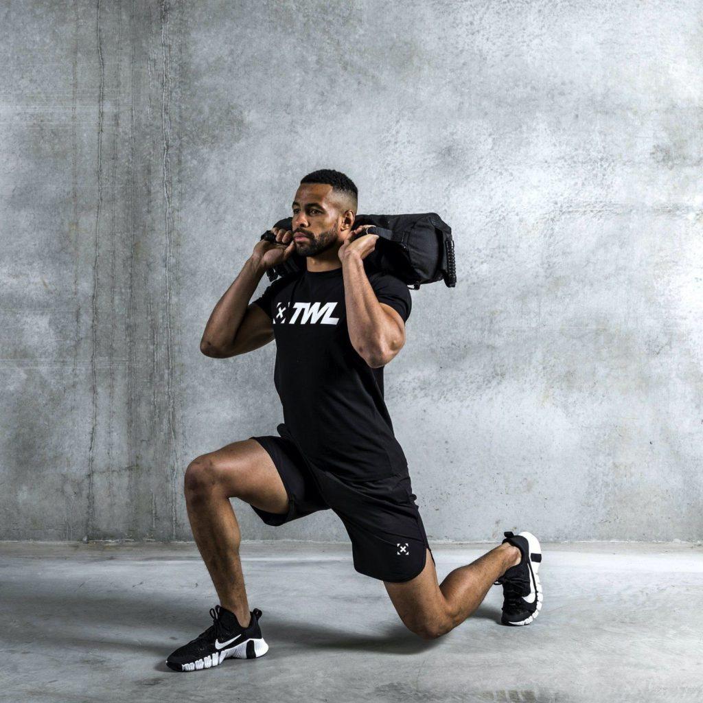 athlete using sandbag