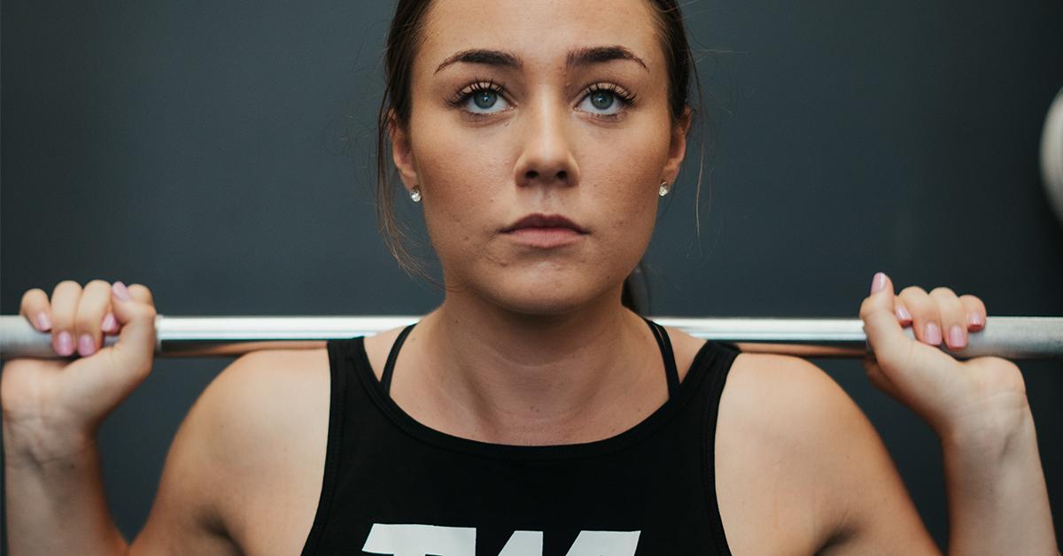 female athlete back squat every day