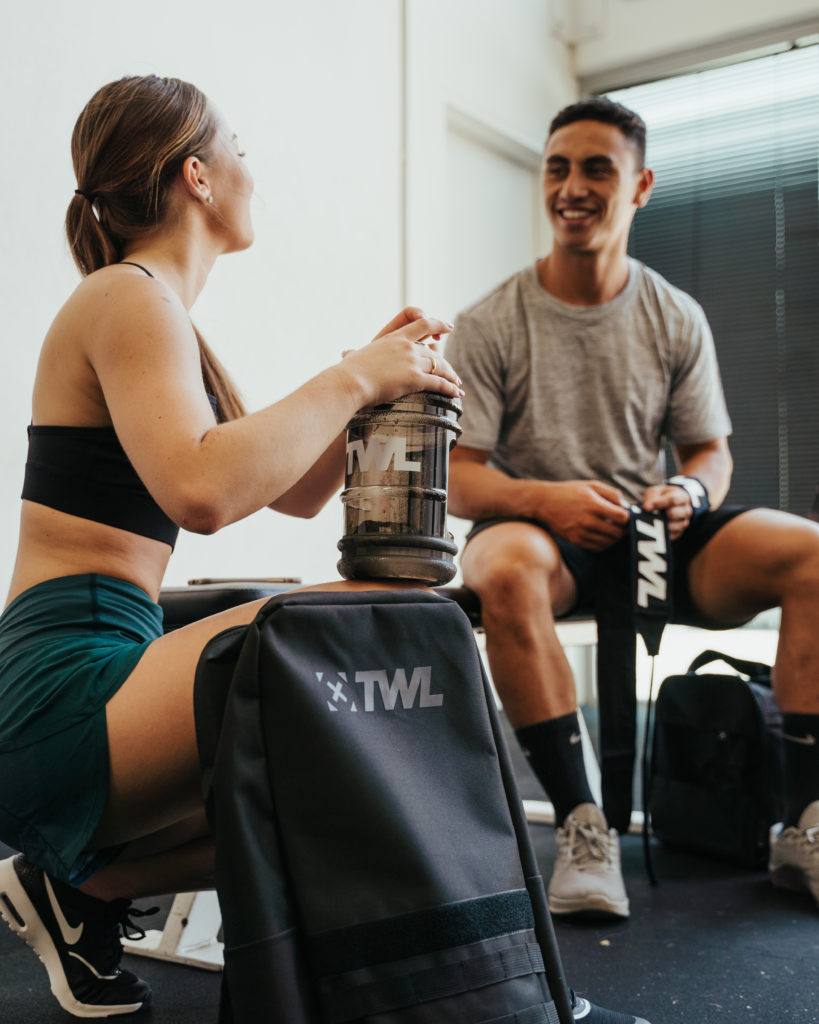 female athlete following nutrition tips and drinking water