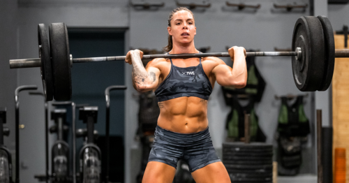female athlete training with barbell