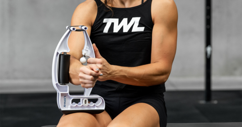 female athlete using trigger point tool on arm