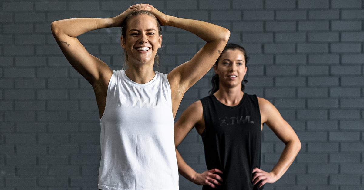female athletes smiling