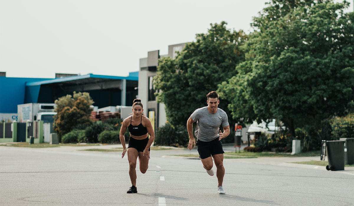 two athletes running wearing training shoes for functional fitness