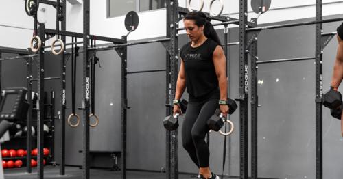 athlete doing dumbbell squat