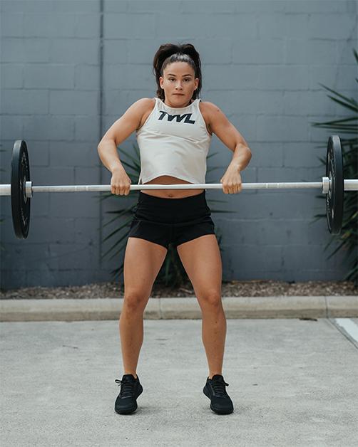 female athlete doing power clean