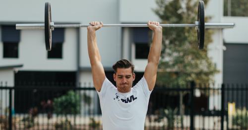 male athlete doing push press