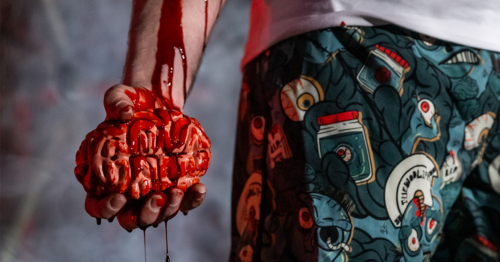zombie holding brain in hand