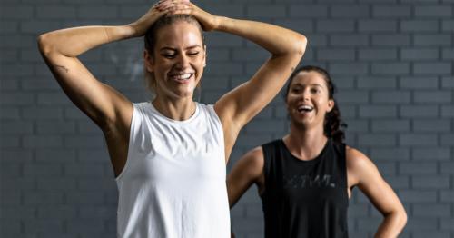 two female athletes smiling